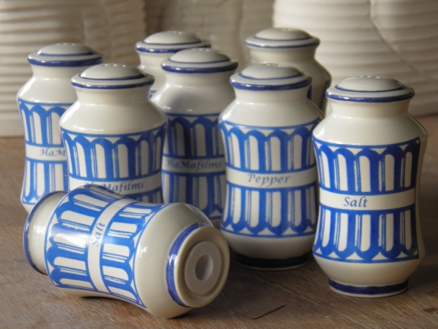 Photo of the salt and pepper shakers, designed by Michael Hunt of Cedar Pottery to commemorate The Skin by HAMAFilms Antigua.
